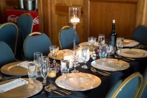 formal table setting on blue table